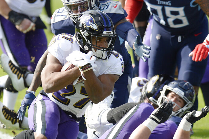 Baltimore Ravens running back J.K. Dobbins (27) carries the ball against the Tennessee Titans in the first half of an NFL wild-card playoff football game Sunday, Jan. 10, 2021, in Nashville, Tenn. (AP Photo/Mark Zaleski)
