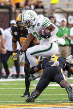 North Texas running back DeAndre Torrey, top, leaps over Missouri defensive back Martez Manuel, bottom, as he runs the ball during the third quarter of an NCAA college football game Saturday, Oct. 9, 2021, in Columbia, Mo. (AP Photo/L.G. Patterson)