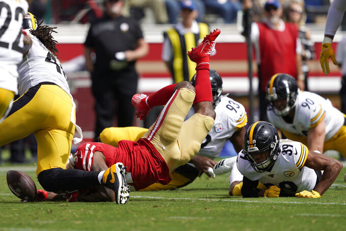 San Francisco 49ers running back Raheem Mostert, bottom left, fumbles the ball in front of Pittsburgh Steelers free safety Minkah Fitzpatrick (39) during the first half of an NFL football game in Santa Clara, Calif., Sunday, Sept. 22, 2019. (AP Photo/Tony Avelar)