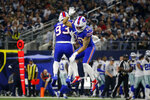 Buffalo Bills' Trent Murphy (93) and Kurt Coleman (28) celebrate a Dallas Cowboys quarterback Dak Prescott (4) fumble recovered by Murphy in the first half of an NFL football game in Arlington, Texas, Thursday, Nov. 28, 2019. (AP Photo/Michael Ainsworth)