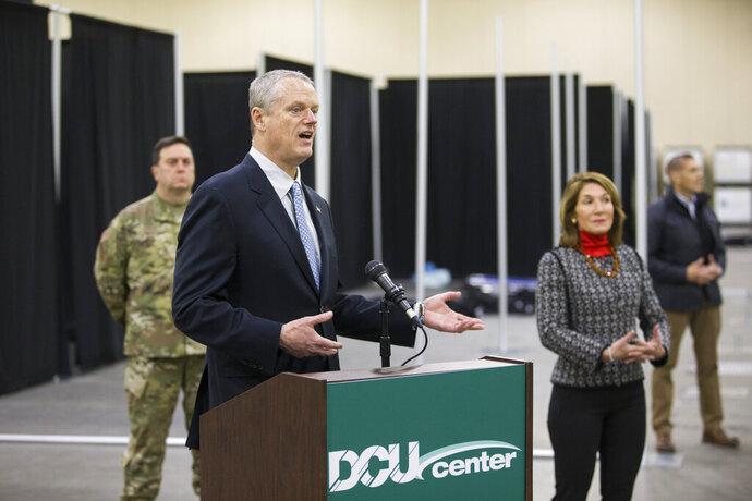 Massachusetts Gov. Charlie Baker, left, Lt. Governor Karyn Polito, right, and Major General Gary W. Keefe of the National Guard, rear, hold a news conference at a medical field hospital erected by the National Guard at the DCU Center in Worcester, Mass. for the expected influx of patients due to the COVID-19 pandemic. (Nicolaus Czarnecki/The Boston Herald via AP, Pool)