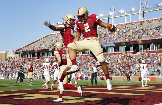 Boston College running back AJ Dillon (2) celebrates with teammate Zay Flowers (4) after scoring a touchdown during the first half of an NCAA college football game against Richmond, Saturday, Sept. 7, 2019, in Boston. (AP Photo/Mary Schwalm)