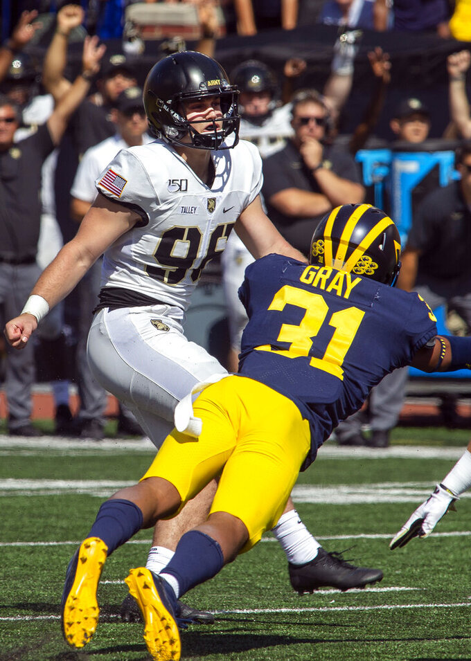 Army kicker Cole Talley (96) watches his 50-yard field goal attempt at the end of the fourth quarter of an NCAA football game against Michigan in Ann Arbor, Mich., Saturday, Sept. 7, 2019. Talley's kick went wide right of and Michigan won 24-21 in double-overtime. (AP Photo/Tony Ding)