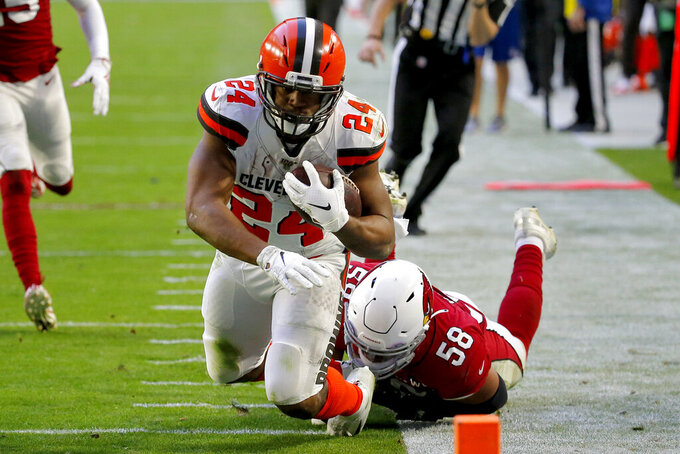 Cleveland Browns running back Nick Chubb (24) is tripped up by Arizona Cardinals middle linebacker Jordan Hicks (58) short of the goal line for a first down during the second half of an NFL football game, Sunday, Dec. 15, 2019, in Glendale, Ariz. (AP Photo/Rick Scuteri)
