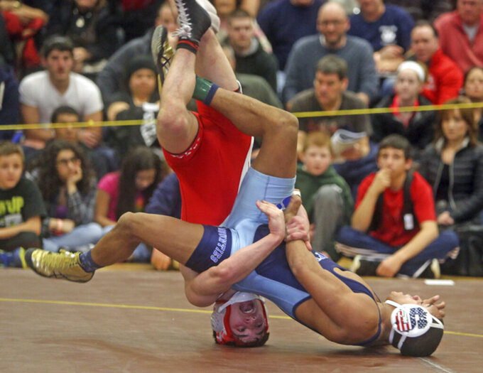FILE- In this Feb. 15, 2015 file photo, Daiton Powell, of Suffern, defeats Matt Grippi, of Fox Lane, 2-1 to win the 132 pound title at the Division 1 high school sectional wrestling championships at Clarkstown South high school in Clarkstown, N.Y. The tentative start date for high-risk winter sports has been moved again for New York high schools, this time to early January 2021, the New York State Public High School Athletic Association announced Tuesday, Nov. 17, 2020. (AP Photo/The Journal News, Carrie Yale, File)