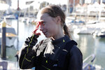 Climate activist Greta Thunberg gives an interview on the quayside in Lisbon, after arriving aboard the sailboat La Vagabonde, Tuesday, Dec 3, 2019. Thunberg has arrived by catamaran in the port of Lisbon after a three-week voyage across the Atlantic Ocean from the United States. The Swedish teen sailed to the Portuguese capital before heading to neighboring Spain to attend the U.N. Climate Change Conference taking place in Madrid. (AP Photo/Armando Franca)