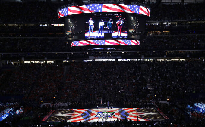 Student athletes perform the national anthem before the semifinals of the Final Four NCAA college basketball tournament between Auburn and Virginia, Saturday, April 6, 2019, in Minneapolis. (AP Photo/Matt York)