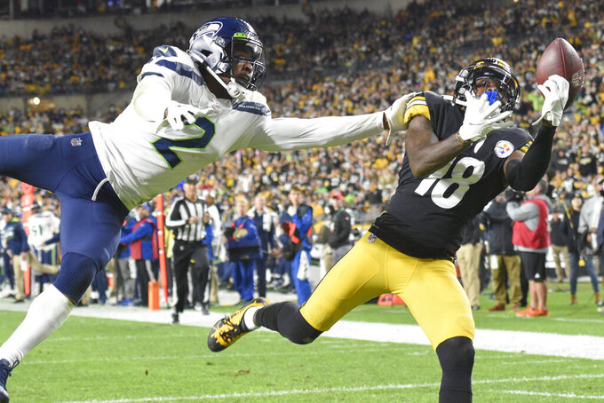 Seattle Seahawks cornerback D.J. Reed breaks up a pass to Pittsburgh Steelers wide receiver Diontae Johnson (18) during the first half an NFL football game, Sunday, Oct. 17, 2021, in Pittsburgh. (AP Photo/Don Wright)