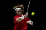 Russia's Andrey Rublev returns the ball to Croatia's Borna Gojo during their Davis Cup tennis match in Madrid, Spain, Monday, Nov. 18, 2019. (AP Photo/Bernat Armangue)