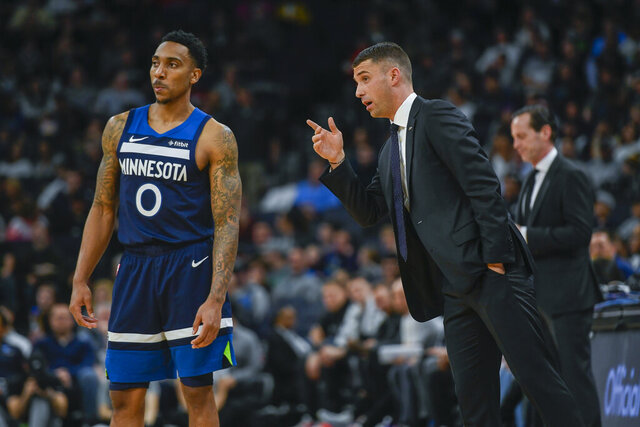 Minnesota Timberwolves head coach Ryan Saunders, right, talks with Minnesota Timberwolves guard Jeff Teague during a break in the action against the Brooklyn Nets during the second half of an NBA basketball game Monday, Dec. 30, 2019, in Minneapolis. (AP Photo/Craig Lassig)