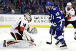 Ottawa Senators goaltender Mike Condon (1) makes a save on a shot by Tampa Bay Lightning center J.T. Miller (10) during the second period of an NHL hockey game Tuesday, March 13, 2018, in Tampa, Fla. (AP Photo/Chris O'Meara)