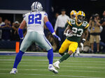 Dallas Cowboys tight end Jason Witten (82) defends as Green Bay Packers cornerback Jaire Alexander (23) returns a Dak Prescott interception in the first half of an NFL football game in Arlington, Texas, Sunday, Oct. 6, 2019. (AP Photo/Michael Ainsworth)