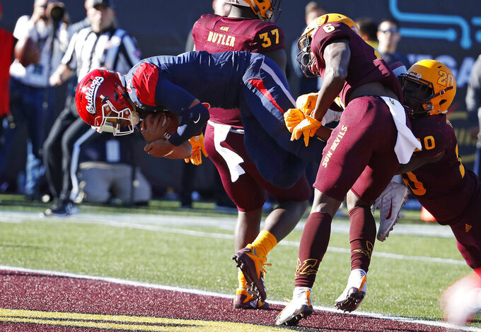 Fresno State quarterback Marcus McMaryion (6) dives into the end zone for a touchdown against Arizona State during the first half of the Las Vegas Bowl NCAA college football game, Saturday, Dec. 15, 2018, in Las Vegas. (AP Photo/John Locher)