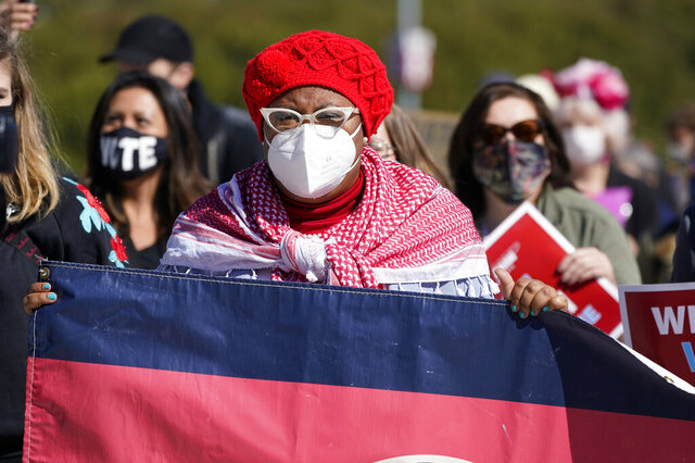 Marquita Bradshaw, the Tennessee Democratic candidate for U.S. Senate, takes part in a Power Together Women's March Saturday, Oct. 17, 2020, in Nashville, Tenn. Dozens of Women's March rallies were planned from New York to San Francisco to signal opposition to President Donald Trump and his policies, including the push to fill the seat of late Supreme Court Justice Ruth Bader Ginsburg before Election Day. (AP Photo/Mark Humphrey)