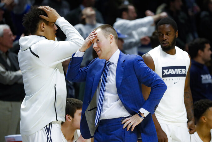 Xavier coach Travis Steele reacts during overtime of the team's NCAA college basketball game against Missouri, Tuesday, Nov. 12, 2019, in Cincinnati. (AP Photo/John Minchillo)