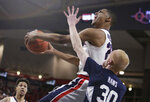 Gonzaga guard Zach Norvell Jr., top, shoots over BYU guard TJ Haws (30) during the first half of an NCAA college basketball game in Spokane, Wash., Saturday, Feb. 23, 2019. (AP Photo/Young Kwak)