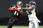 Atlanta Falcons wide receiver Julio Jones (11) makes the catch aganst Seattle Seahawks cornerback Shaquill Griffin (26) during the second half of an NFL football game, Sunday, Sept. 13, 2020, in Atlanta. (AP Photo/Brynn Anderson)
