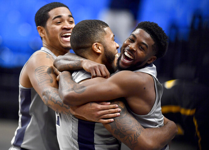 Penn State's Myles Dread is hugged by teammate Jamari Wheeler after his buzzer-beater for the win over VCU during an NCAA college basketball game Wednesday, Dec. 2, 2020, in State College, Pa. (Abby Drey/Centre Daily Times via AP)