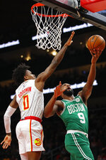 Boston Celtics guard Brad Wanamaker (9) goes up for the shot as Atlanta Hawks guard Brandon Goodwin (0) defends in the first half of an NBA basketball game on Monday, Feb. 3, 2020, in Atlanta. (AP Photo/Todd Kirkland)