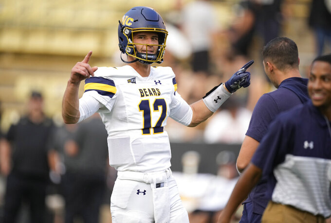 Northern Colorado quarterback Dylan McCaffrey jokes with teamamtes as they warm up before an NCAA college football game against Colorado, Friday, Sept. 3, 2021, in Boulder, Colo. (AP Photo/David Zalubowski)