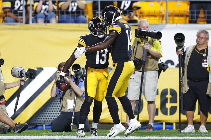 Pittsburgh Steelers wide receiver James Washington (13) celebrates his touchdown against the Tampa Bay Buccaneers with wide receiver Tevin Jones (14) during the first half of an NFL preseason football game in Pittsburgh, Friday, Aug. 9, 2019. (AP Photo/Keith Srakocic)