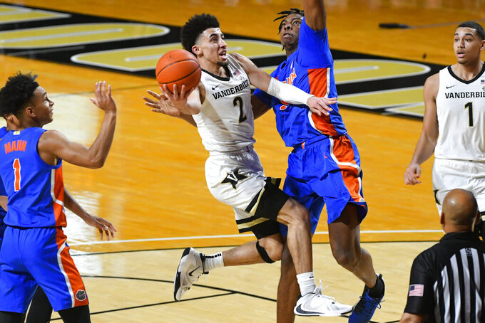Vanderbilt guard Scotty Pippen Jr. (2) goes up to shoot as Florida forward Omar Payne defends during the first half of an NCAA college basketball game Wednesday, Dec. 30, 2020, in Nashville, Tenn. (AP Photo/John Amis)