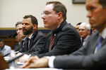 Facebook Head of Global Policy Development Matt Perault, second from left, testifies alongside Google Director of Economic Policy Adam Cohen, back left, Amazon Associate General Counsel Nate Sutton, second from right, and Apple Vice President for Corporate Law and Chief Compliance Officer Kyle Andeer during a House Judiciary subcommittee hearing, Tuesday, July 16, 2019, on Capitol Hill in Washington. (AP Photo/Patrick Semansky)