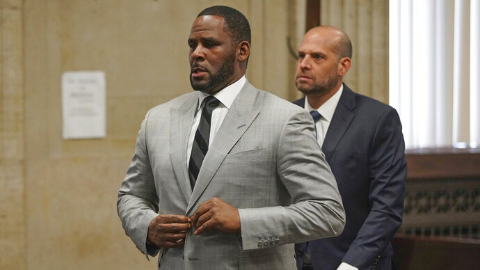 FILE - In this  June 6, 2019, file photo, singer R. Kelly pleaded not guilty to 11 additional sex-related felonies during a court hearing before Judge Lawrence Flood at Leighton Criminal Court Building in Chicago. R. Kelly, already facing sexual abuse charges brought by Illinois prosecutors, was arrested in Chicago Thursday, July 11, 2019 on a federal grand jury indictment listing 13 counts including sex crimes and obstruction of justice. (E. Jason Wambsgans/Chicago Tribune via AP, Pool)