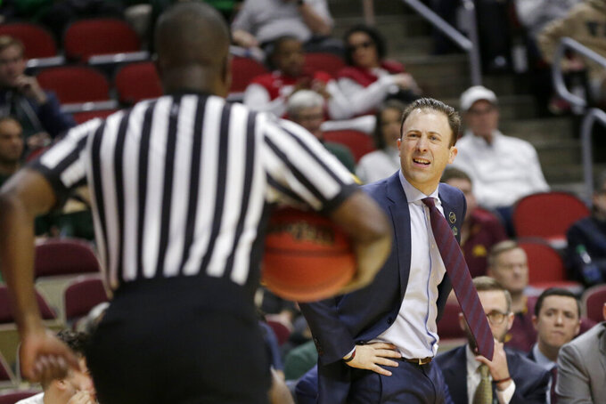 Minnesota coach Richard Pitino questions a call during the first half of a first round men's college basketball game against Louisville in the NCAA Tournament, in Des Moines, Iowa, Thursday, March 21, 2019. (AP Photo/Nati Harnik)