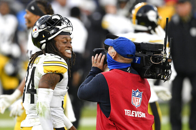 Pittsburgh Steelers strong safety Terrell Edmunds (34) smiles for a television camera after an NFL football game against the Baltimore Ravens, Sunday, Nov. 1, 2020, in Baltimore. The Steelers won 28-24. (AP Photo/Nick Wass)