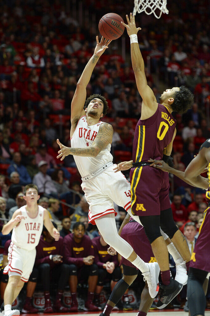 Utah forward Timmy Allen (1) stretches out for a shot as Minnesota guard Payton Willis (0) defends during an NCAA college basketball game Friday, Nov. 15, 2019, in Salt Lake City. (Francisco Kjolseth/The Salt Lake Tribune via AP)