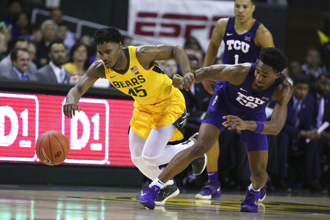 Baylor guard Davion Mitchell, left, battles TCU guard RJ Nembhard, right, for a loose ball in the second half of an NCAA college basketball game, Saturday, Feb. 1, 2020, in Waco, Texas. Baylor won 68-52. (AP Photo/Rod Aydelotte)