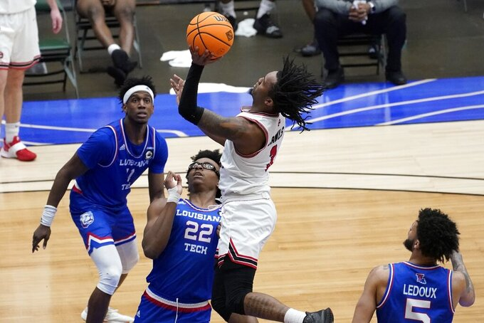 Western Kentucky guard Jordan Rawls (3) shoots over Louisiana Tech forward Isaiah Crawford (22) in the second half of an NCAA college basketball game in the quarterfinals of the NIT, Thursday, March 25, 2021, in Frisco, Texas. (AP Photo/Tony Gutierrez)