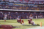 New York Giants wide receiver Sterling Shepard (87) falls into the end zone for a touchdown after making a catch on a pass from quarterback Daniel Jones, not visible, as Washington Redskins strong safety Landon Collins (20) tries to defend during the first half of an NFL football game, Sunday, Dec. 22, 2019, in Landover, Md. Giants' Golden Tate (15) reacts on the play. (AP Photo/Alex Brandon)