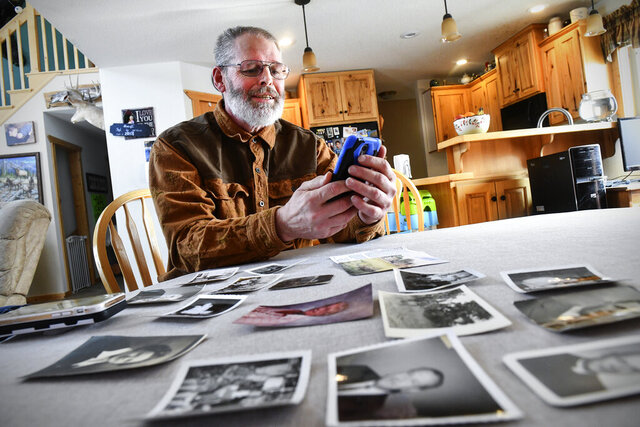Rick Colbert talks on the phone with Chuck Owen Saturday, Feb. 8, 2020, at his home near Bemidji, Minn. Owen stayed in St. Cloud with Colbert's grandparents 70 years ago. The two were connected after Owen reached out to the community for information on the Colbert family and to thank them for taking him in. (Dave Schwarz/ The St. Cloud Times via AP)