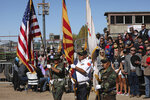 Navajo Nation members George Kee, far left, Richard David and Wayne Begay serve as the color guard for a rally Thursday, Oct. 15, 2020, in Williams, Arizona, that served as the launch of the Native Americans for Trump coalition. (Jake Bacon/Arizona Daily Sun via AP)