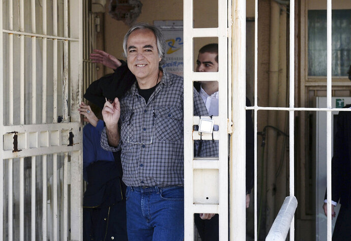 FILE - In this Thursday, Nov. 9, 2017 file photo, Dimitris Koufodinas smiles as he leaves Korydallos prison in western Athens.  A Greek far-left extremist serving 11 life terms for a string of murders is vowing to continue