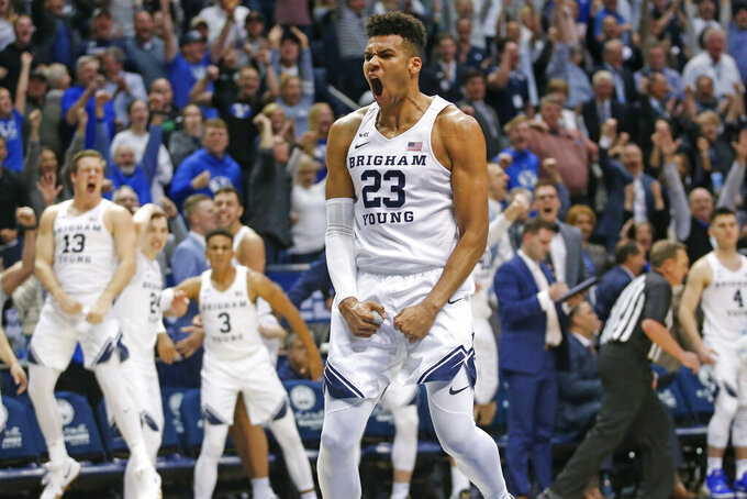 BYU forward Yoeli Childs (23) reacts after dunking against Gonzaga during the second half of an NCAA college basketball game Saturday, Feb. 22, 2020, in Provo, Utah. (AP Photo/Rick Bowmer)