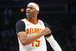 Atlanta Hawks forward Vince Carter reacts after making a three-point basket during the first half of an NBA basketball game against the Utah Jazz, Thursday, March 21, 2019, in Atlanta. (AP Photo/John Amis)