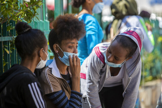 An Ethiopian domestic worker cries as she waits with dozens of others outside the Ethiopian consulate, some inquiring about flights home, others stranded after they were abandoned by employers who claimed they could no longer afford to pay their salaries, in Hazmieh, east of Beirut, Lebanon, Thursday, June 4, 2020. Some 180,000 domestic workers in Lebanon, most of them female from Ethiopia, are growing more desperate as a crippling economic and financial crisis sets in, coupled with coronavirus restrictions. (AP Photo/Hassan Ammar)