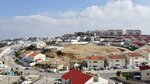 A view overlooks the Jewish West Bank settlement of Ari'el, Tuesday, Jan. 28, 2020. President Donald Trump is set to unveil his administration's much-anticipated Mideast peace plan in the latest American venture to resolve the Israeli-Palestinian conflict. (AP Photo/Ariel Schalit)