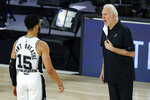 San Antonio Spurs head coach Gregg Popovich talks with Quinndary Weatherspoon (15) during the second half of an NBA basketball game against the Utah Jazz, Friday, Aug. 7, 2020, in Lake Buena Vista, Fla. (Kevin C. Cox/Pool Photo via AP)