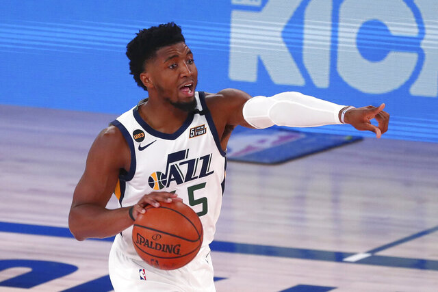 Utah Jazz guard Donovan Mitchell dribbles the basketball against the Denver Nuggets in Game 2 of an NBA basketball first-round playoff series, Wednesday, Aug. 19, 2020, in Lake Buena Vista, Fla. (Kim Klement/Pool Photo via AP)