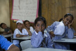 Palestinian girls attend a lesson at the start of the new school year, in the West Bank Bedouin community of Khan al-Ahmar, Monday, July 16, 2018. The Palestinian ministry of education has decided to start the school-year early in the village in that is slated for demolition. The ministry says it's trying to pre-empt any Israeli move by starting school early for 170 elementary students in Khan al-Ahmar and four nearby Bedouin communities. AP Photo/Nasser Nasser)