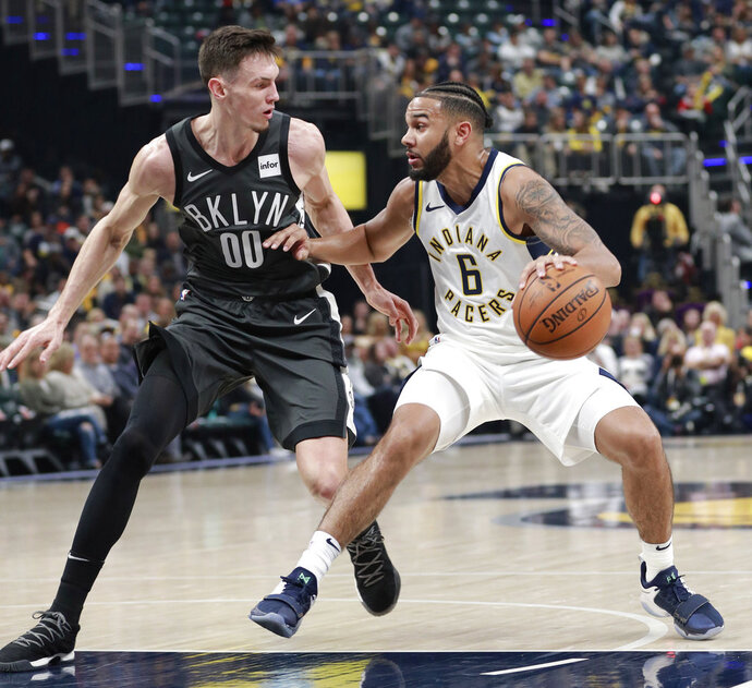 Indiana Pacers guard Cory Joseph (6) controls the basketball defended by Brooklyn Nets forward Rodions Kurucs in the first half of an NBA basketball game, Saturday, Oct. 20, 2018, in Indianapolis. Indiana won 132-112. (AP Photo/R Brent Smith)