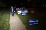 FILE - In this Tuesday, Sept. 15, 2020 file photo, transgender activist Sarah McBride, who hopes to win a seat in the Delaware Senate, walks next to campaign signs at Immanuel Church Highlands in Wilmington, Del. The run-up to the Nov. 3, 2020 general election has been a mix of excitement and apprehension for McBride, who has been a spokeswoman for the Human Rights Campaign for several years and is now running for a seat in the Delaware Senate. (AP Photo/Jason Minto)