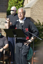 """Greater Milwaukee Synod Bishop Paul Erickson addresses the crowd in front of Grace Lutheran Church in Kenosha, Wis., during a service Wednesday, Sept. 2, 2020, in response to the previous week's police shooting of Jacob Blake. Erickson denounced racism as """"that toxic poison that is harming us all."""" (Dan Truttschel/The Kenosha News via AP)"""