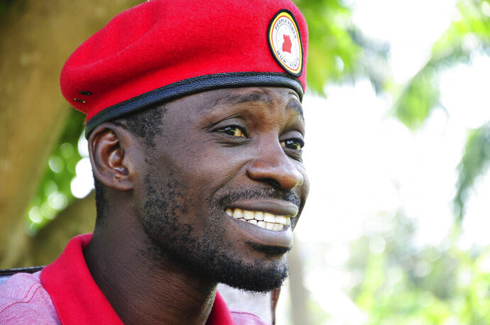 Pop star-turned-opposition lawmaker Bobi Wine, whose real name is Kyagulanyi Ssentamu, is seen while giving an interview to Associated Press at his home,Magere in Kampala, Uganda Monday, July 15, 2019. Bobi Wine, Uganda's pop star-turned-opposition leader, says he will challenge longtime President Yoweri Museveni in polls set for 2021, but Wine, says he is concerned about his safety.(AP Photo/Ronald Kabuubi)
