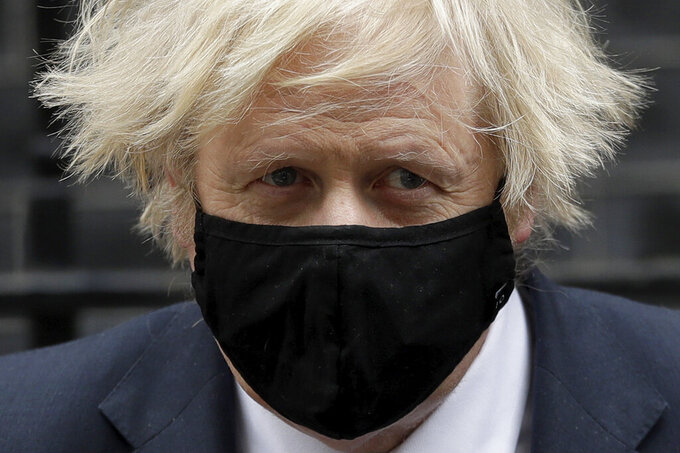 British Prime Minister Boris Johnson leaves 10 Downing Street in London, to attend the weekly Prime Minister's Questions at the Houses of Parliament, in London, Wednesday, March 24, 2021. (AP Photo/Matt Dunham)