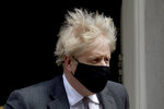 British Prime Minister Boris Johnson leaves 10 Downing Street in London, to attend the weekly Prime Minister's Questions at the Houses of Parliament, in London, Wednesday, April 21, 2021. (AP Photo/Matt Dunham)